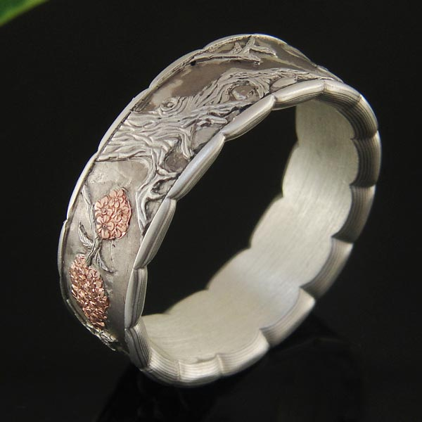 Rose gold inlay is used to accent and add an iridescent sparkle to the cherry tree - $6995.00