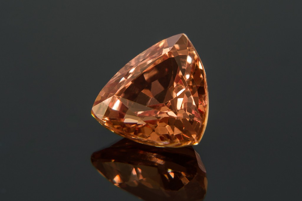 Rare indeed, a Padparadscha sapphire radiates with a distinctive pink tone, akin to that of a lotus blossom.