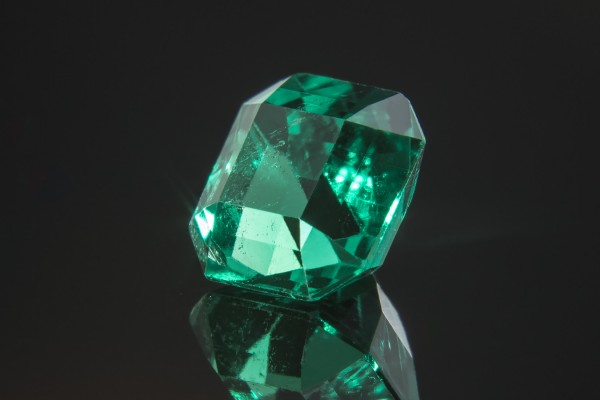 An emerald's distinct coloring is owed to trace ammounts of chromium, vanadium, and iron. The emerald cut – with its precise facets and steps used on a variety of other gems - is best suited for emerald's long six-sided prisms (hence the cut's name.)