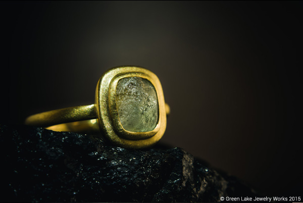 18kt yellow brushed gold ring featuring a rough un-cut Montana sapphire center. Available for sale HERE.