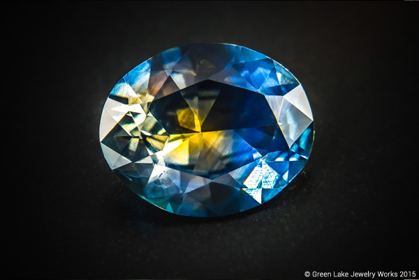 An oval-cut untreated Montana sapphire with an emblematic corn-flower blue coloring and flash of golden yellow in its center, viewed only from certain angles.