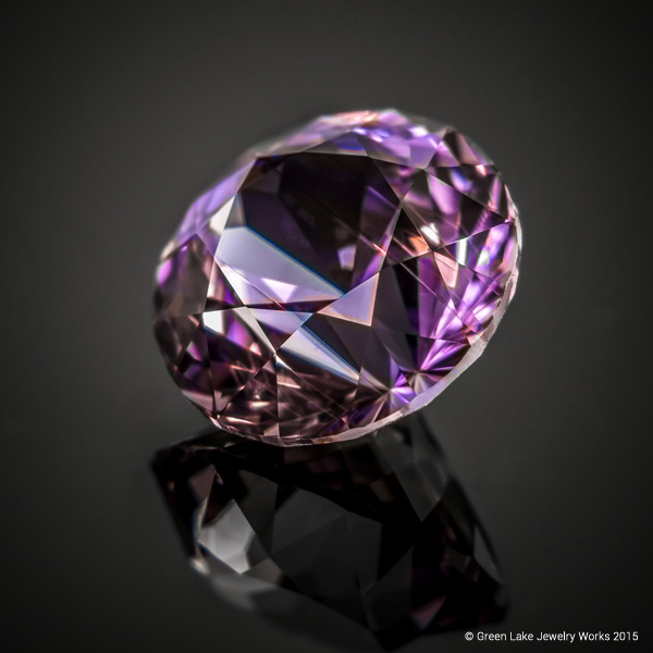 One of the rarest colors of sapphire is lavender. This round brilliant from Montana gleams with velvety iridescence.