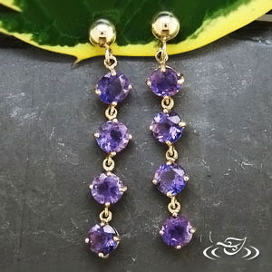 Amethyst and 14k gold dangle earrings, $465.