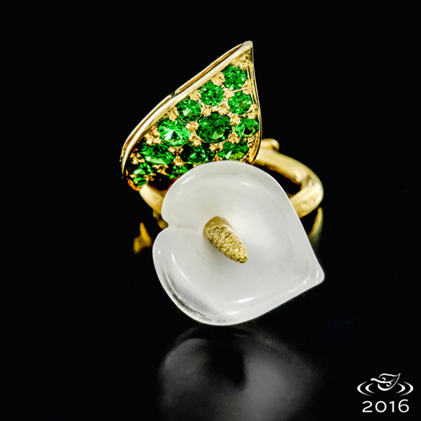 Hand fabricated in Fairmined certified 18k gold, hand carved moonstone, pave of Tsavorite garnet and natural yellow diamond melee.